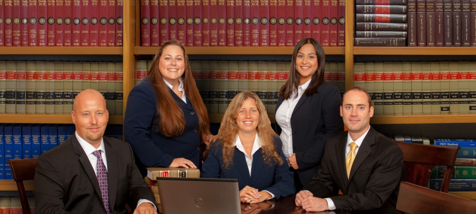 Homepage little side bar photo of all attorneys on bookcase